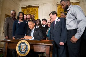 Obama signs minimum wage order. WH Photo by Churck Kennedy.