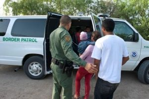 Family at the border. Is RAC Act the solution? Customs and Border Protection photo.