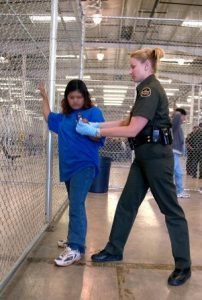 U.S. Border Patrol agent conducts a pat down. Courtesy CBP.