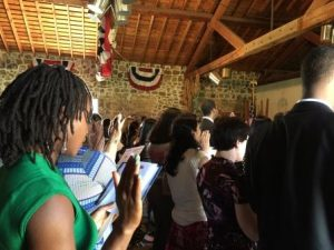 Naturalization ceremony: immigrants become real Americans. NPS/Celeste Dixon.
