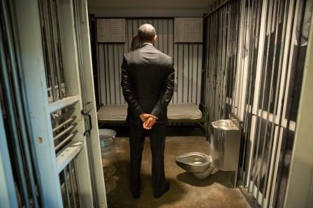 Barack Obama inside replica prison cell.
