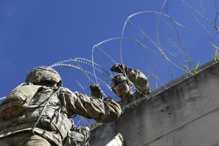 Soldiers install concertina wire barricade at Hidalgo port of entry. DoD photo by Daniel Hernandez.
