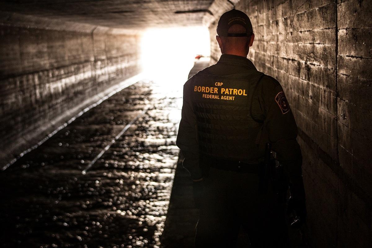 Border Patrol agents inspect tunnel. Josh Denmark/CBP.