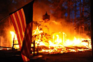 Flag in front of burning structure. Black Forest Fire. DoD photo by Master Sgt. Christopher DeWitt, U.S. Air Force.