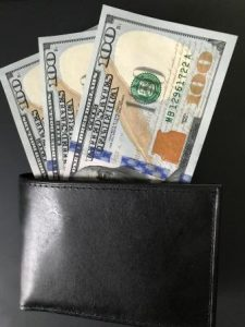 Wallet with three one hundred dollar bills
