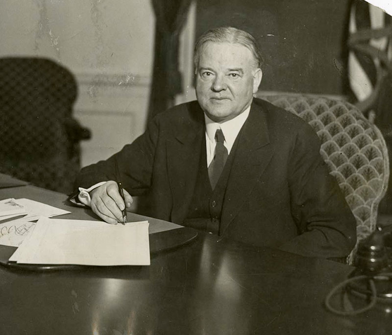 Herbert Hoover signs bill. Courtesy Herbert Hoover Presidential Library and Museum.