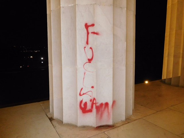 Graffiti on Lincoln Memorial. U.S. Park Police photo.